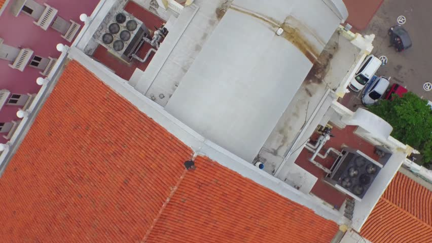Aerial shot Cartagena, flying over colonial building with red tiled roof  #17998780