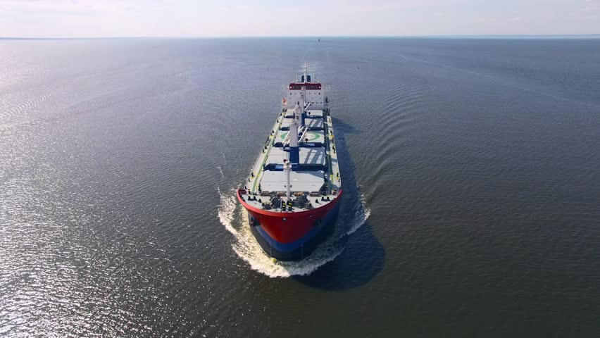 Aerial view of cargo ship in the sea