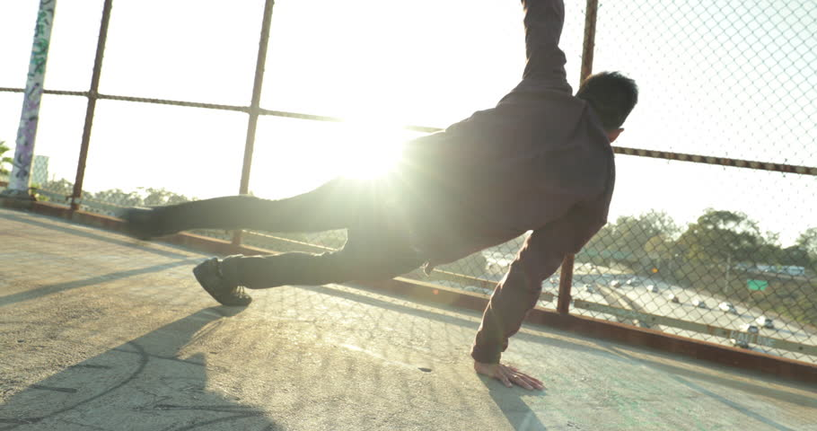Young Man Breakdancing At Sunset
