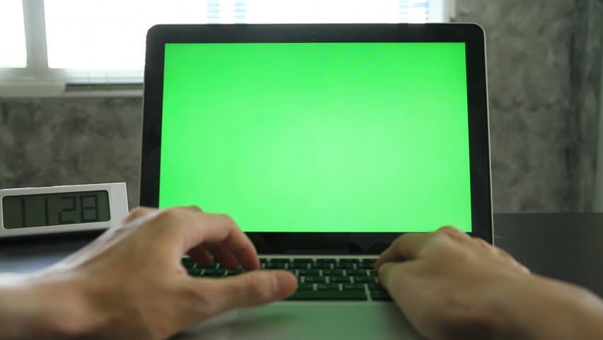 Man working with blank green screen on Laptop. | Shutterstock HD Video #18007177