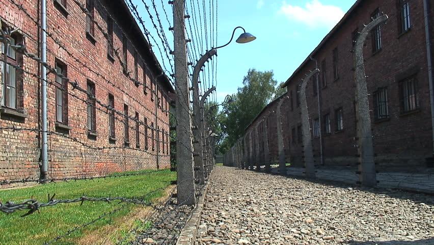 AUSCHWITZ, POLAND - CIRCA 2010: Walkway and barbed wire fence at Auschwitz-Birkenau Concentration Camp.