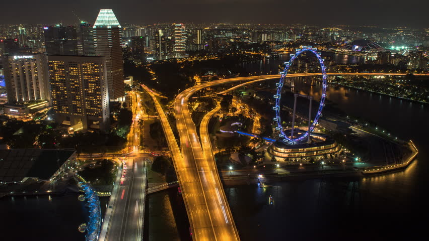 MARINA BAY SINGAPORE, 9 JULY 2016 - Night Aerial Time-lapse of Marina Bay Area Overlooking The Singapore Flyer and Highway