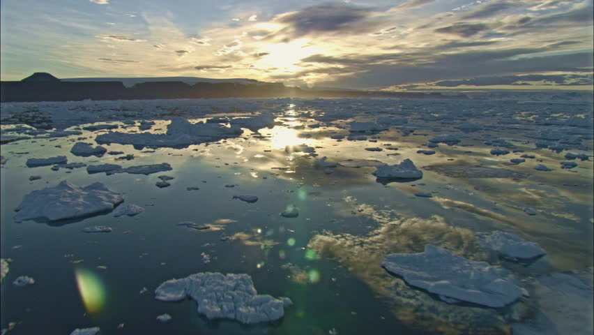 WS POV Ice floating on water reflecting clouds/ Antarctica(Antarctica - 38717)