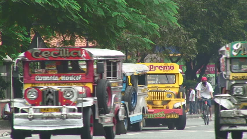 MANILA,  PHILIPPINES - CIRCA 2011: Colorful buses in downtown Manila, Philippines
