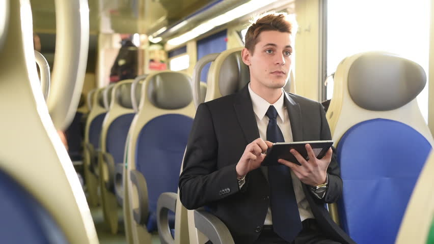 MS SELECTIVE FOCUS SHAKY Young businessman using digital tablet in train / Milan, Italy | Shutterstock HD Video #18102349