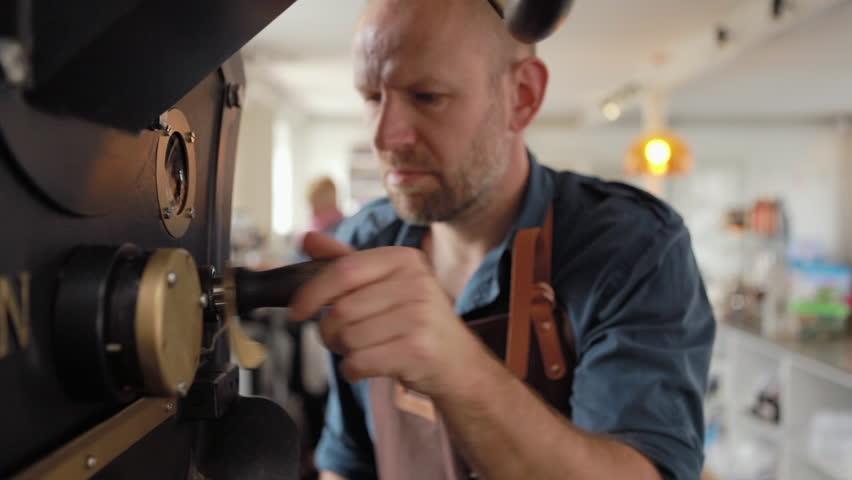 MS Worker smelling coffee sample in processing factory / Humlebaek, Denmark