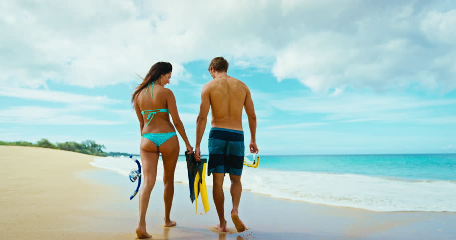 Happy romantic couple snorkeling at the beach