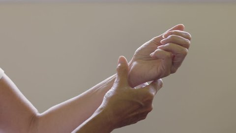 Woman with arthritis in hand and wrist, close up