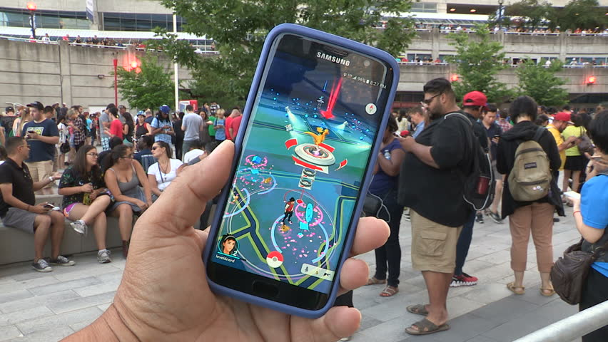 Toronto, Ontario, Canada July 2016 Crowds of people playing Pokemon GO in downtown Toronto