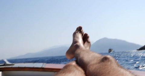 Feet on Boat Travel in Capri Island, Italy