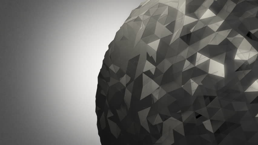 A rotating gray orb made of reflective random pieces of charcoal glass against a subtle off white background. | Shutterstock HD Video #18214390