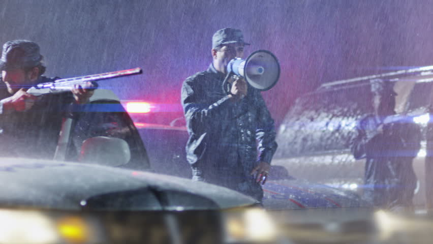 4K  Police surrounding on the rain. Police attack. Armed policemen take aim to the offender. Another policeman speaks on rupper.  Shot on RED EPIC Cinema Camera in slow motion.