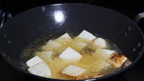 Frying Paneer cubes or tofu cubes in oil