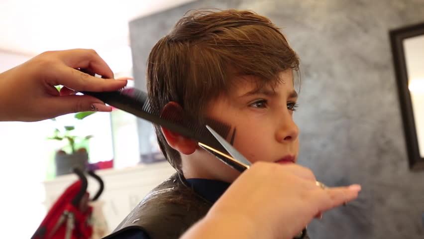 Young Boy Having A Haircut At The Barbershop Kid Getting