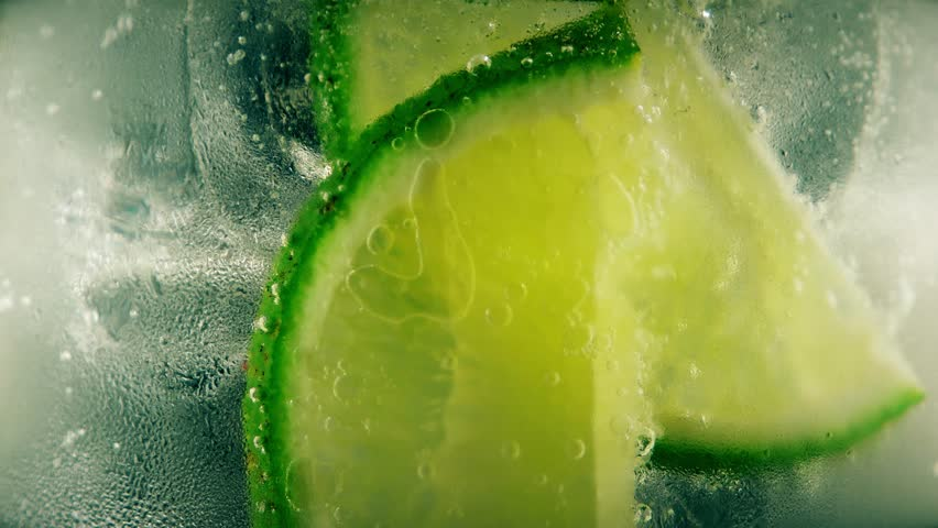 Cold cocktail with lime, tonic and ice, closeup #18273025