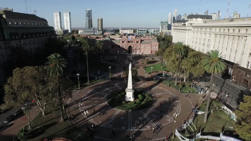 Aerial Drone scene of the Plaza de Mayo square with the historic Piramide de Mayo in Buenos Aires