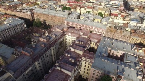 Aerial flight over Saint Petersburg center downtown. View of sightseeing from above. Unique footage. Rooftops and road traffic.