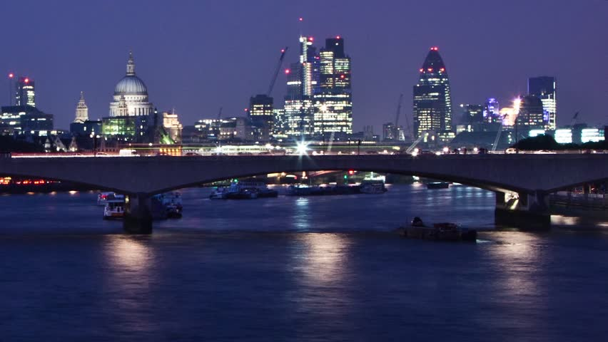 WATERLOO, LONDON - JULY 2011: Time lapse of Waterloo bridge as traffic and boat go by.