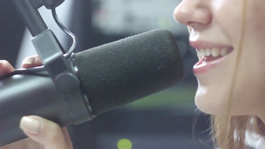 girl talking into the microphone