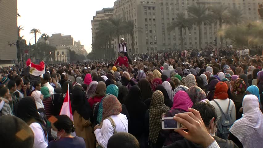 CAIRO, EGYPT - NOV 19: Young protesters in Tahrir Square chant slogans on November 19, 2011 in Cairo, Egypt.
