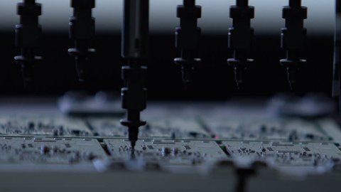 Robotic production of printed Circut Board. Producing Printed Circut Board. Electronics contract manufacturing. Manufacture of electronic chips. High-tech manufacturing.