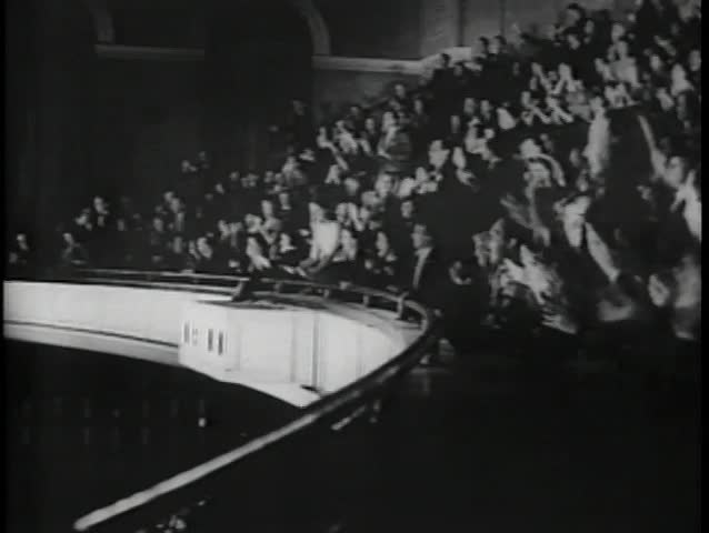 Audience in balcony fervently applauding