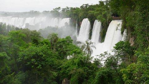 Panning shot of Iguazu Falls. Border of Brazil and Argentina