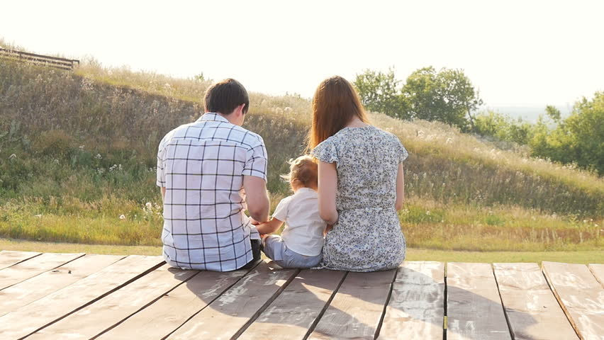 Happy young family spending time outdoor on a autumn day | Shutterstock HD Video #18522428
