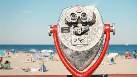 Classic retro coin operated binoculars viewing machine at beach