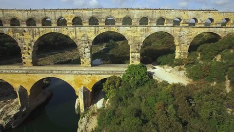 Europe, France, Gard, aerial view of the roman Bridge over the Gard river, le pont du Gard listed as World Heritage by UNESCO, 4k movie (3820 x 2160), lateral travelling