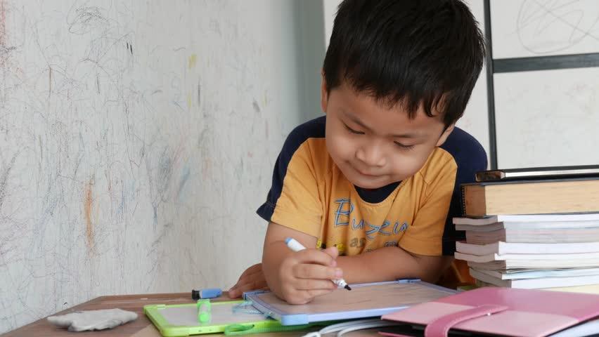 4k Little boy writing on white board in the room   Shutterstock HD Video #18593090