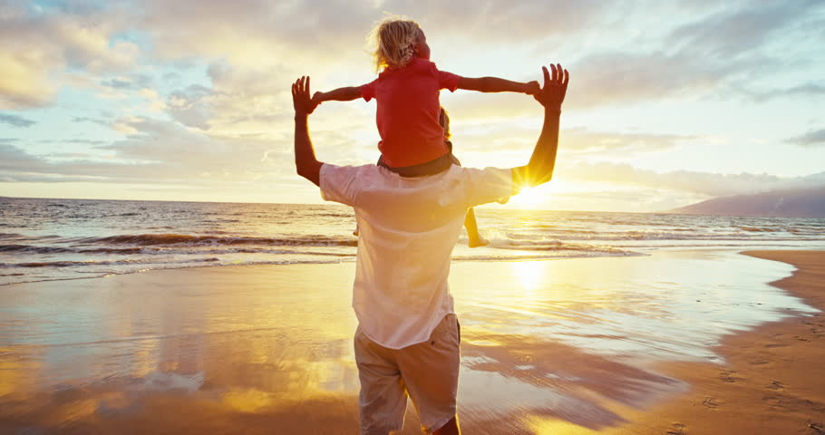 Happy father and son playing on the beach at sunset | Shutterstock HD Video #18597320