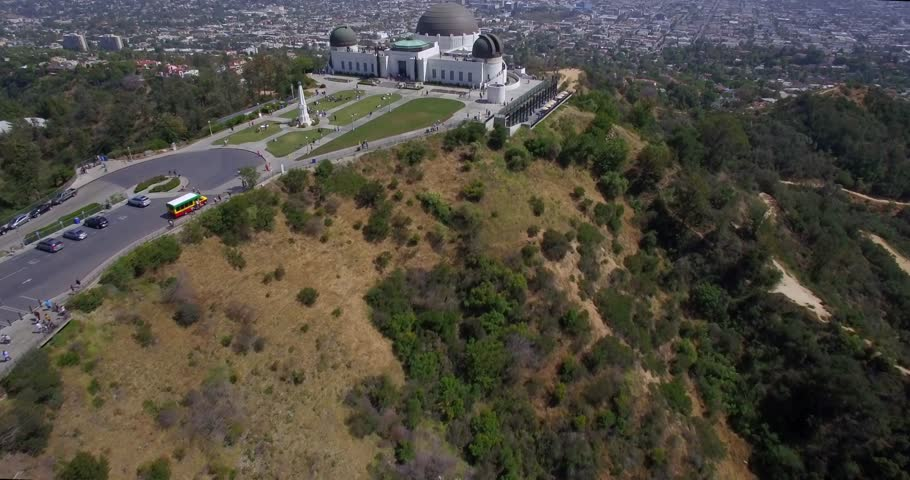 Observatory Park Los Angeles / Multiple aerial clips of flying over Griffith Observatory with people underneath and the downtown Los Angeles skyline.
