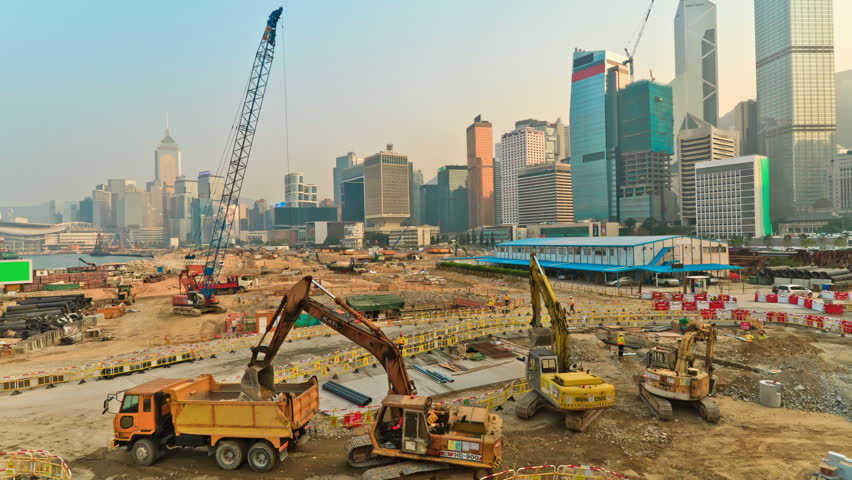 Operation of construction equipment during putting up skyscraper on the background of a megacity Hong Kong, timelapse #1860904