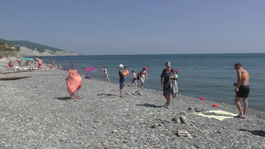 Image of: Epic Novorossiyskrussia Jul 30 2016 View Of Standing People In Grey Pebble Beach Near Blue Sea And White Cliff On Background Little Boy In White Cap And Shutterstock Novorossiyskrussia Jul 30 2016 Stock Footage Video 100 Royalty