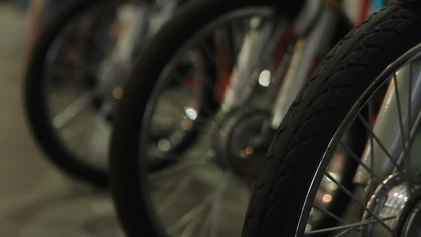 Electric bicycles standing in line for sale at showroom, vehicle rent business | Shutterstock HD Video #18695150