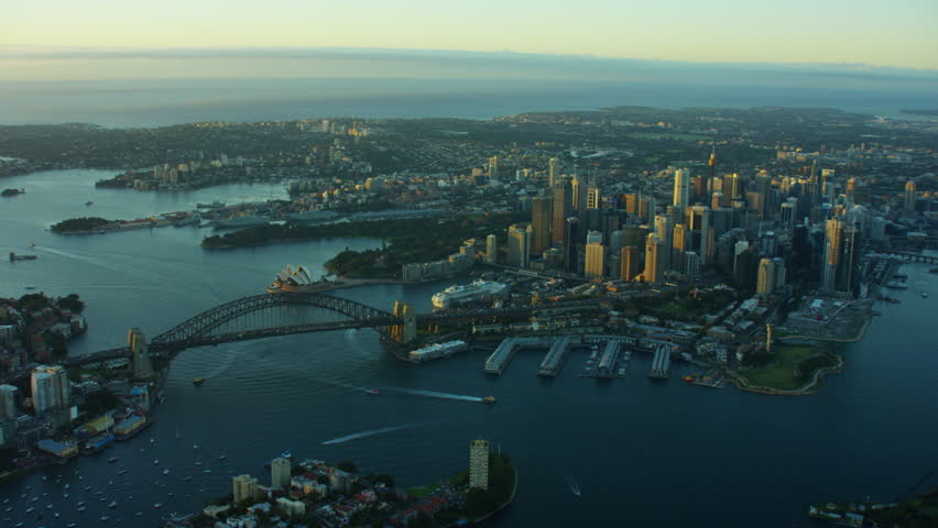 Aerial view at sunrise of Sydney Harbour Bridge and downtown city buildings