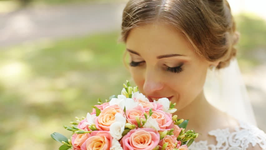Portrait of beautiful bride with bouquet over green nature background, smiley face of happy woman, head and shoulder female portrait #18713360
