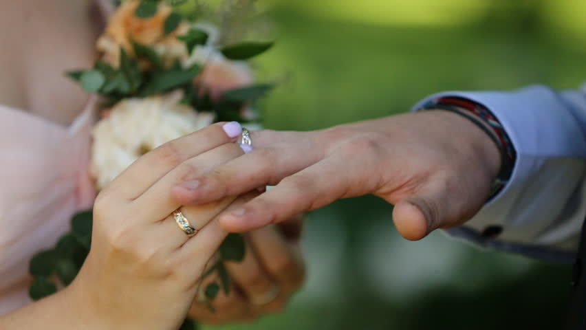 Stock Video Clip of Bride putting wedding ring on groom39s finger