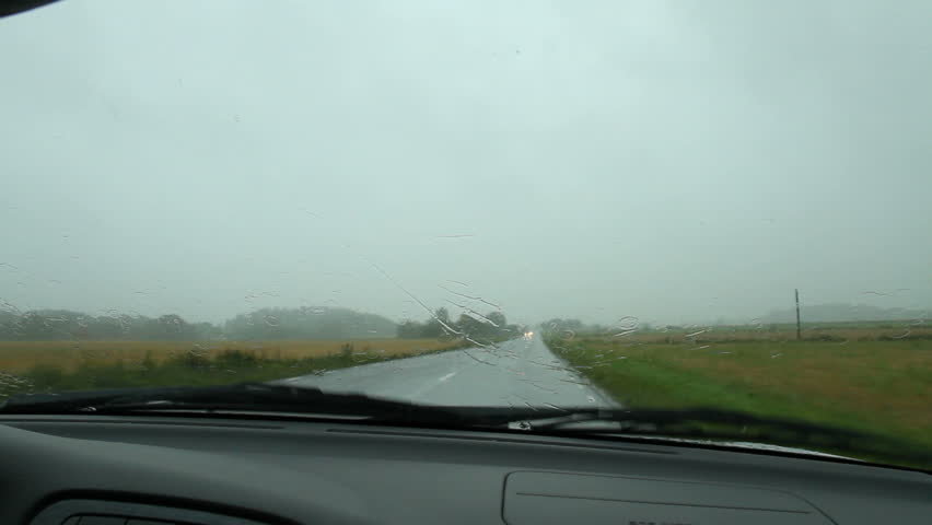 Driving on a rainy Swedish road with the wipers on
