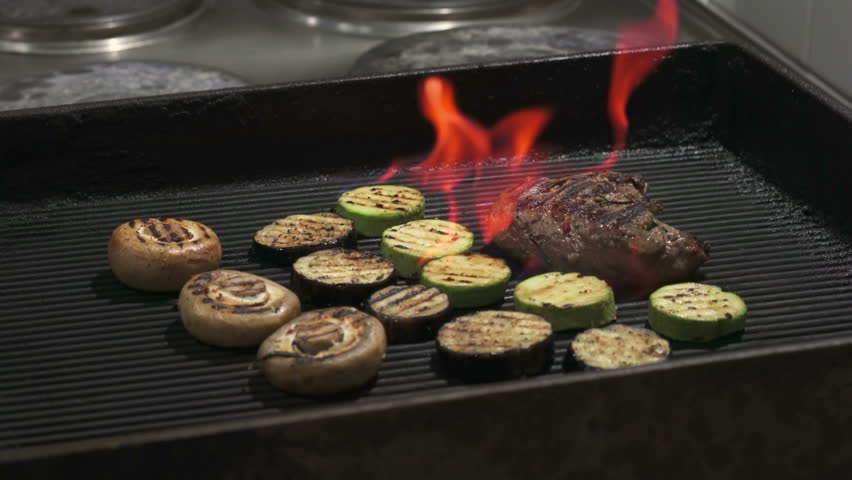 Juicy steaks sizzle on flaming and smoking grill | Shutterstock HD Video #18732440