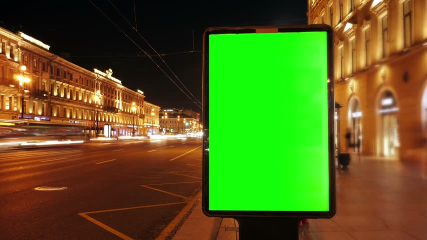 A Billboard with a Green Screen on a Busy  Street,Time Lapse.
