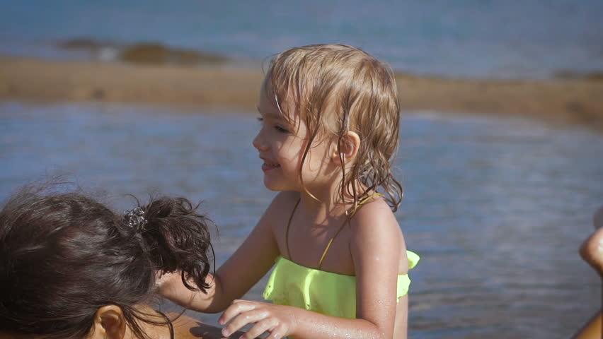 Cute little blonde girl having fun by a lake | Shutterstock HD Video #18800750