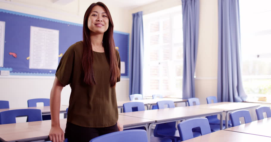 4k,Portrait of a happy and proud high school teacher in a classroom. Slow motion. | Shutterstock HD Video #18817283