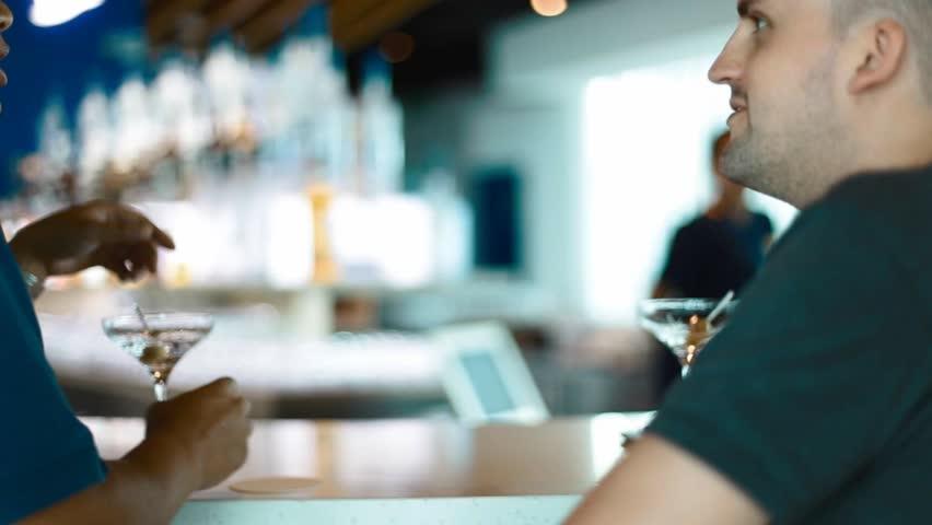 KUALA LUMPUR,MALAYSIA - CIRCA July 2016 :Two men converse over drinks at the bar counter   Shutterstock HD Video #18851270