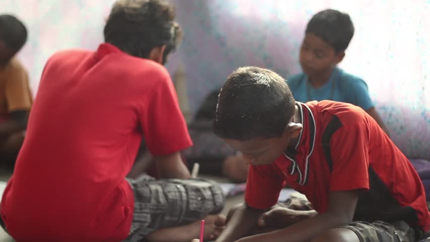 Boy students diligently study, in a village school in Bengal, India. Tilt shot from the side, narrow depth of field | Shutterstock HD Video #18853187