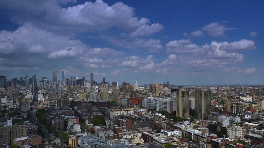 A dramatic day time lapse of puffy summer clouds passing over Midtown Manhattan.  	 | Shutterstock HD Video #18868040