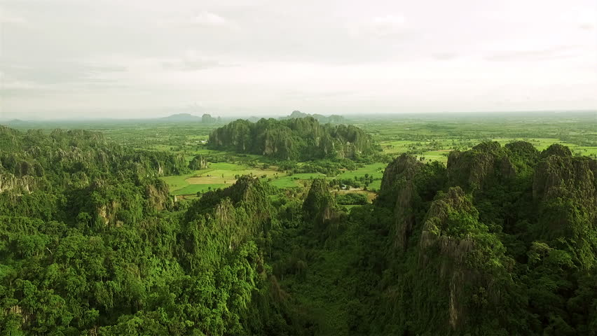 Aerial view of limestone mountain Karst, the Avatar-like mountain pass of sharp cliffs, peak forest and sinkhole landscape at Noen Maprang district of Phitsanulok Province, northern Thailand.