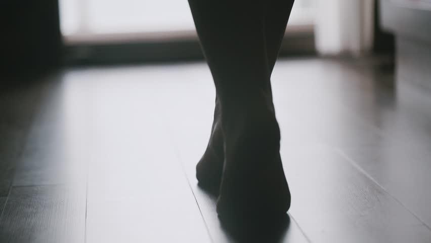 Morning, beautiful female feet get down on tiptoes.
