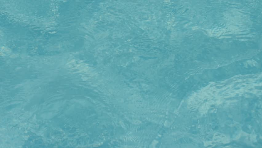 Pool Water Splash jacuzzi water in swimming pool with spa. close up jacuzzi blue